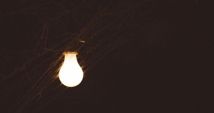 Cobwebs around a lightbulb