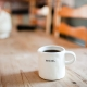 Photo of a mug with the word Begin printed on it.